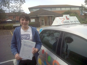 Craig with his Practical Driving Test Pass Certificate outside Weston-super-Mare Driving Test Centre.