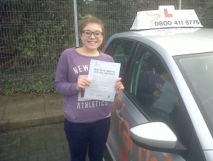 Katie with her Practical Driving Test Pass Certificate outside Taunton Driving Test Centre