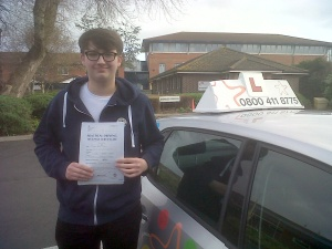 Pete with his Driving Test Pass Certificate outside Weston-super-Mare Driving Test Centre