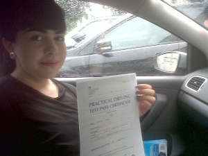 Sophia with her Practical Driving Test Pass Certificate somewhere in Mark.