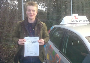 Tim with his Practical Driving Test Pass Certificate outside Taunton Driving Test Centre.
