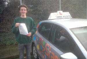 Will with his Practical Driving Test Pass Certificate outside Taunton Driving Test Centre