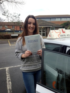 Grace with her Practical Driving Test Pass Certificate outside Weston-super-Mare Driving Test Centre.