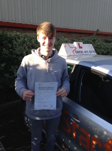 Josh with his Practical Driving Test Pass Certificate outside Weston-Super-Mare Driving Test Centre