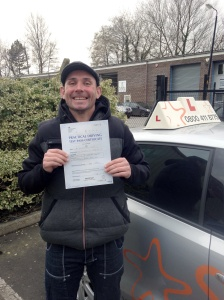Keith with his Practical Driving Test Pass Certificate outside Weston-super-Mare Driving Test Centre