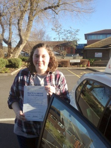 Maddie with her Practical Driving Test Pass Certificate outside Weston-super-Mare Driving Test Centre.