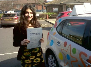 Athina with her Practical Driving Test Pass Certificate outside Weston-super-Mare Driving Test Centre.