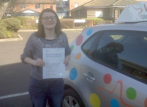 Emma with her Practical Driving Test Pass Certificate outside Weston-super-Mare Driving Test Centre.