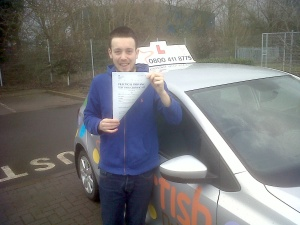 Jacob holding on tightly to his Practical Driving Test Certificate outside Taunton Driving Test Centre