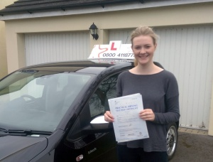 Katie with her Practical Driving Test Pass Certificate.