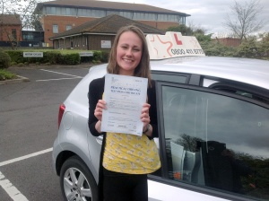 Abigail with her Practical Pass Test Certificate outside Weston-Super-Mare Driving Test Centre