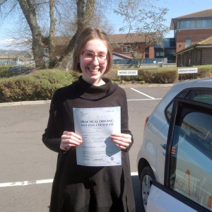 Imogen with her Pracitcal Drving Test Pass Certificate outside Weston-Super-Mare Driving Test Centre