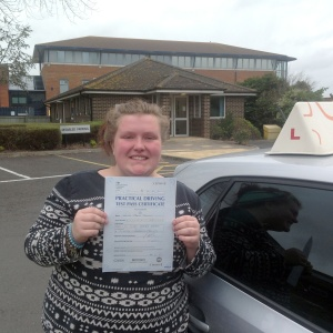 Kelsey with her Practical Driving Test Pass Certificate outside Weston-Super-Mare Driving Test Centre.