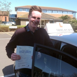 Tim with his Practical Driving Test Pass Certificate outside Weston-super-Mare Driving Test Centre.