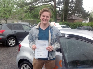 Alex with his Practical Driving Test Pass Certificate outside Sidcot School