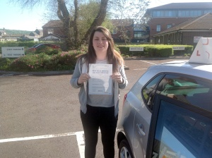 Alice with her Practical Driving Test Pass Certificate outside Weston-super-Mare Driving Test Centre