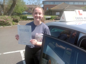 Jessica with her Practical Driving Test Pass Certificate outside Weston-super-Mare Driving Test Station.