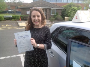 Lydia with her Practical Driving Test Pass Certificate outside Weston-Super-Mare Driving Test Centre