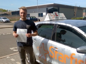 Tom with his Practical Driving Test Pass Certificate outside Taunton Driving Test Centre