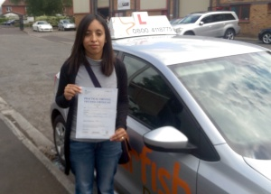 Claudia with her Practical Driving Test Pass Certificate outside Weston-super-mare Driving Test Centre.