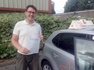 Matthew with his Practical Driving Test Pass Certificate outside Weston-super-mare Driving Test Centre