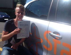 Nick with his Practical Driving Test Pass certificate outside Weston-super-Mare Driving Test Centre