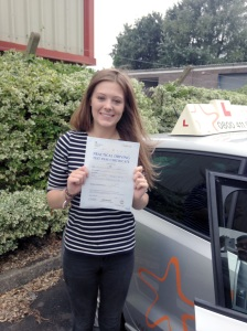 Annabel with her Practical Driving Test Pass Certificate outside Weston-Super-Mare Driving Test Centre