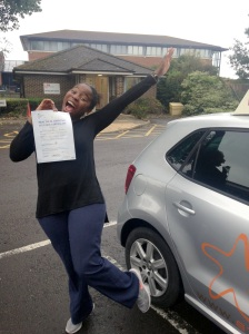 A happy Bongai with her Practical Driving Test Pass Certificate outside Weston-super-Mare Driving Test Centre.