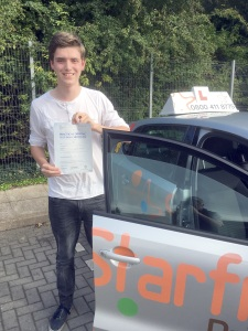 Jack with his Practical Driving Test Pass Certificate outside Taunton Driving Test Centre