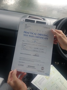 Josh with his Practical Driving Test Pass Certificate.