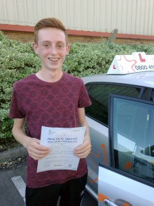 Robert with his Practical Driving Test Pass Certificate outside Weston-Super-Mare Driving Test Centre