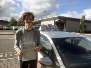 Josh with his Practical Driving Test Pass Certificate outside Taunton Driving Test Centre