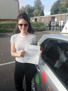 Kelly with her Practical Driving Test Pass Certificate outside Weston-super-mare Driving Test Centre.