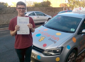 Kyle with his Practical Driving Test Pass Certificate somewhere in Weston-super-mare