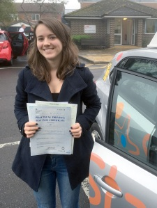 Lucy with her Practical Driving Test Pass Certificate outside Weston-super-mare Driving Test Centre