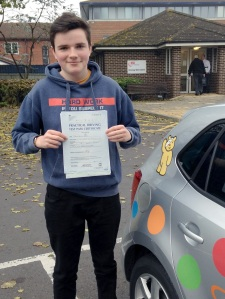 Tom with his Practical Driving Test Pass Certificate outside Weston-Super-Mare Driving Test Centre
