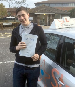 Tommy with his Practical Driving Test Pass Certificate outside Weston-super-Mare Driving Test Centre