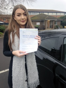 Cara with her Pracitcal Driving Test Pass Certificate outside Weston-super-mare Driving Test Centre