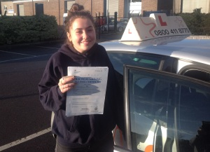Emily with her Practical Driving Test Pass Certificate outside Weston-super-mare Driving Test Centre