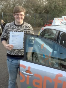 Fergus with his Practical Driving Test Pass Certificate outside Taunton Driving Test Centre