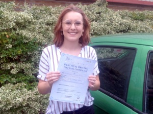 Lizzie with her Practical Driving Test Pass Certificate outside Weston-super-mare Driving Test Centre