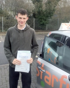 Matt with his Practical Driving Test Pass Certificate outside Taunton Driving Test Centre