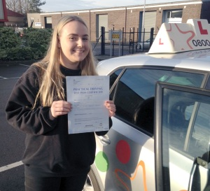Naomi with her Practical Driving Test Pass Certificate outside Weston-super-mare Driving Test Centre