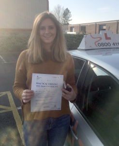 Becca with her Practical Driving Pass Certificate outside Weston-Super-Mare Driving Test Centre.