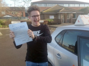 George with his Practical Driving Test Pass Certificate outside Weston-super-mare Driving Test Centre.