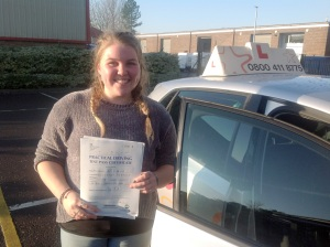 Hattie with her Practical Driving Test Pass Certificate outside Weston-super-mare Driving Test Centre