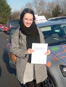 Anna with her Practical Driving Test Pass Certificate.