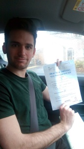 Joe with his Practical Driving Test Pass Certificate.