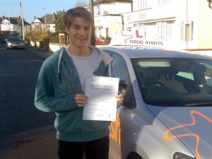 Joseph with his Practical Driving Test Pass Certificate somewhere in Weston