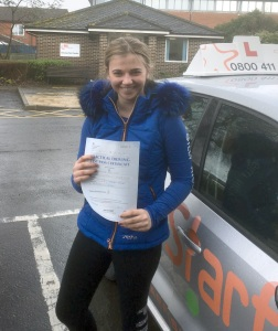 Phoebe with her Practical Driving Test Pass Certificate outside Weston-super-mare Driving Test Centre